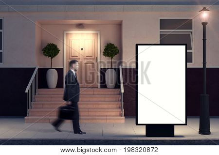 Side view of blurry businessman passing empty ad stand placed outside next to building with nice porch. Night. Advertising concept. Mock up 3D Rendering