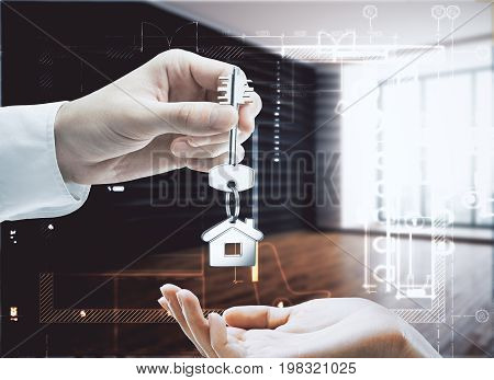 Businessman handing key with house keychain to female in modern interior with daylight. Landlord concept. 3D Rendering