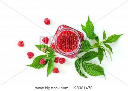 Homemade Jam. Glass Jar With Raspberry Jam On A White Background. Preserved Berry. Top View.