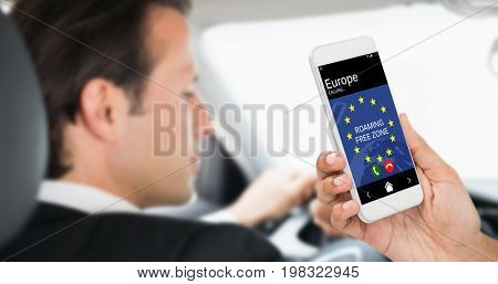 Cropped image of businesswoman holding smart phone against businessman in the drivers seat
