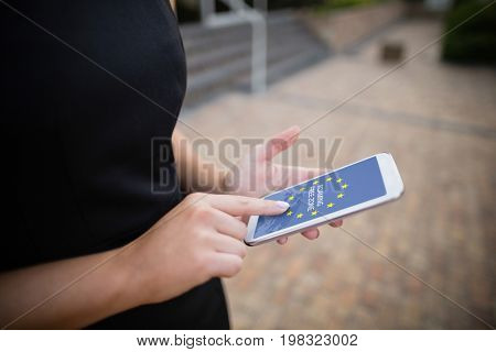 Roaming free zone text on European Union flag against businesswoman using mobile phone
