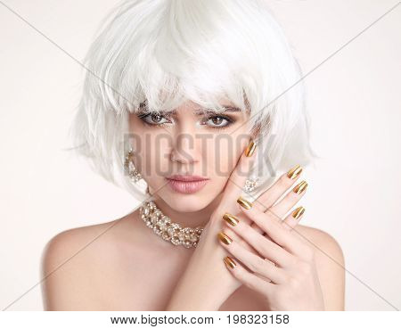 Beauty Blonde. Blond bob hairstyle. Manicured nails. Fashion girl model with makeup, short hair, golden jewelry set isolated on white background.