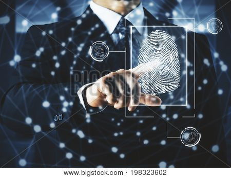 Businessman pointing at abstract digital finger print hologram. Security concept. Double exposure