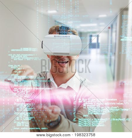 Happy man gesturing while using virtual reality glasses against college hallway