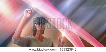 Smiling mature woman using virtual reality glasses against view of empty cafeteria