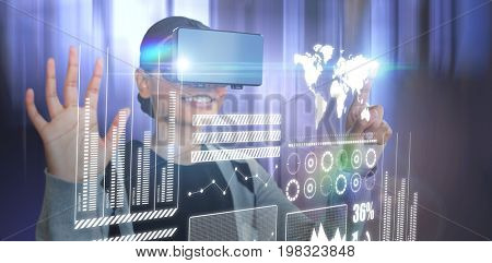 Smiling woman gesturing while wearing black virtual reality glasses against tables in office cafeteria