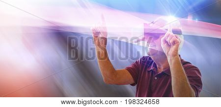 Happy senior man dancing while using virtual reality glasses against table and empty chairs in office