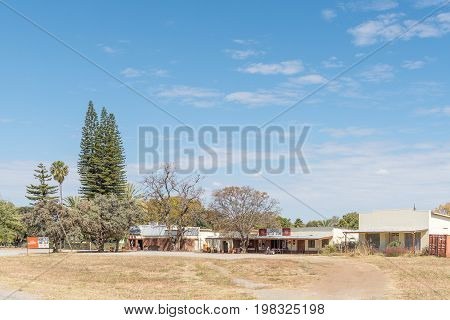 KOMBAT NAMIBIA - JUNE 20 2017: A shopping centre with liquor store in Kombat in the Otjozondjupa Region of Namibia