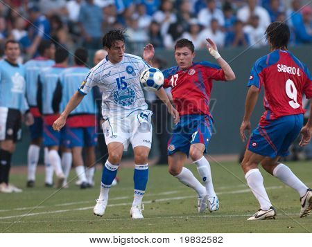 CARSON, CA. - JULY 3: Concacaf Gold Cup soccer match, Costa Rica vs. El Salvador at the Home Depot center in Carson. Alfredo Pacheco, Pablo Herrera and Alvaro Saborio fighting for the ball on July 3, 2009.