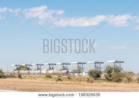GROOTFONTEIN NAMIBIA - JUNE 20 2017: Railroad tankers being offloaded to storage tanks at Grootfontein in the Otjozondjupa Region of Namibia