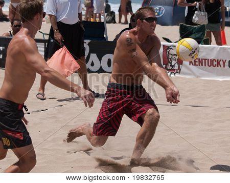 MANHATTAN BEACH, CA. - JULY 18: Jeff Carlucci and Adam Roberts at the AVP Manhattan Beach Open on July 18, 2009 in Manhattan Beach, CA.