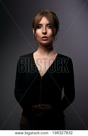 Beautiful Woman With Elegant Neck In Fashion Black Jacket Looking Mystic And Calm On Dark Shadow Gre