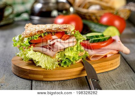 Sandwich With Ham, Cucumber, Tomato And Lettuce.