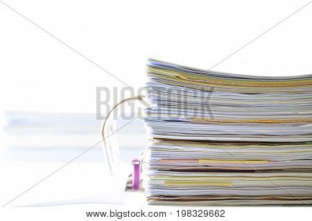 Stack of documents in document file on white background with high key tone,business concept.