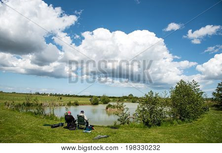 Kent United Kingdom- 14 May 2017: Mature adult men fishing at a beautiful lake near sandwich city at Kent district United Kingdom.