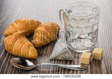 Cup, Teabag, Croissants, Brown Sugar And Teaspoon