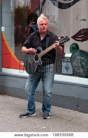 August 4th, 2017, Cork, Ireland - man busking on St. Patrick street