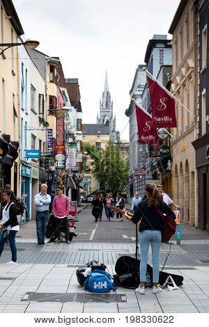 August 4th, 2017, Cork, Ireland - woman busking on Oliver Plunkett street