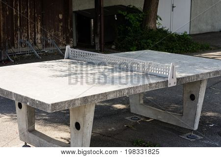 outdoor ping pong table from concrete with a net