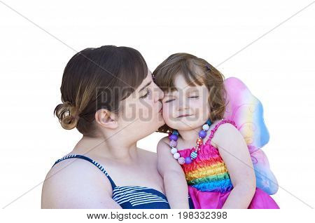 Mother kissing daughter in costume with fairy wings