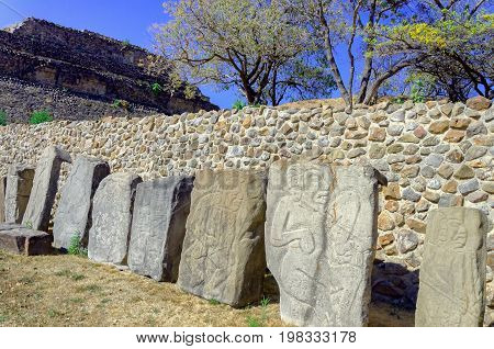 Stones of the dancers in the plaza of the dancers in Monte Alban ruins in Oaxaca Mexico