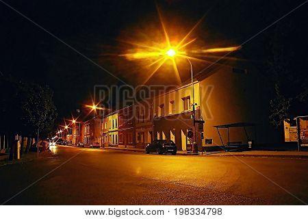 Lovosice, Czech Republic - July 05, 2017: Black Car Opel Astra H Stay Under Lamp In Dlouha Street Wi