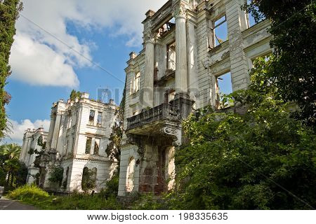 Overgrown ruins of beautifull abandoned mansion, Abkhazia. Green post-apocalyptic concept