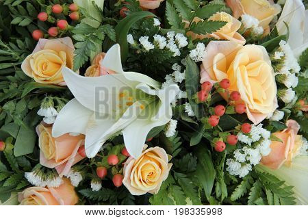 White tiger lillies and yellow pink roses in a bridal bouquet