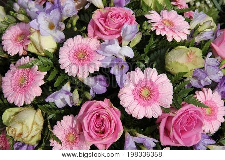 Bridal bouquet: pink roses and gerberas and purple freesias