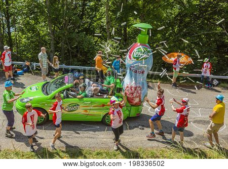 Mont du Chat France - July 9 2017: Excited fans trying to catch the gifts thrown from a Teisseire vehicle during the passing of Publicity Caravan on Mont du Chat during the stage 9 of Tour de France 2017.