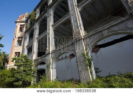 Overgrown ruins of beautifull abandoned palace, Abkhazia. Green post-apocalyptic concept