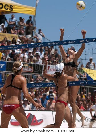 HERMOSA BEACH, CA. - AUGUST 8: Jen Kessy (R) and April Ross vs. Nicole Branagh (L) and Elaine Youngs (MID) for the womens final of the AVP Hermosa Beach Open. August 8, 2009 in Hermosa Beach.