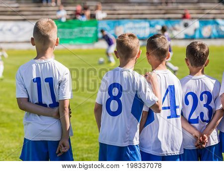 Young Boys Soccer Football Players. Youth Footballers on the Field. Children Sport Soccer Youth Team