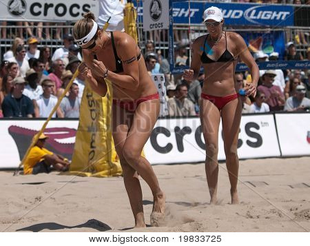 HERMOSA BEACH, CA. - AUGUST 8: Jen Kessy and April Ross vs. Nicole Branagh (L) and Elaine Youngs (R) for the womens final of the AVP Hermosa Beach Open. August 8, 2009 in Hermosa Beach.