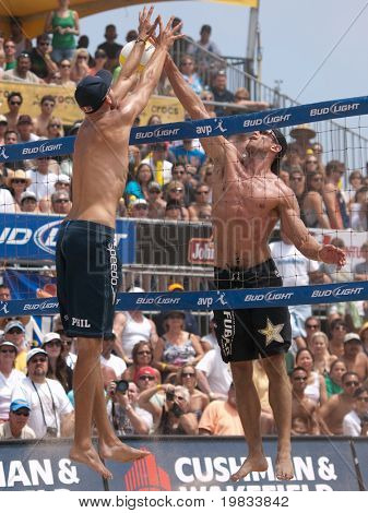 HERMOSA BEACH, CA. - AUGUST 9: Phil Dalhausser (L) and Todd Rogers vs. John Hyden and Sean Scott (R) for the mens final of the AVP Hermosa Beach Open. August 9, 2009 in Hermosa Beach.
