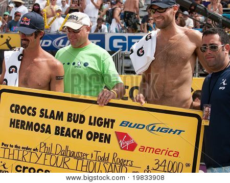 HERMOSA BEACH, CA. - AUGUST 9: Phil Dalhausser (R) Todd Rogers (L)  and representatives from Crocs and AVP after they won the mens final of the AVP Hermosa Beach Open. August 9, 2009 in Hermosa Beach.