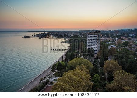 Evening sunset over black sea. Sukhum, Abkhazia, aerial view
