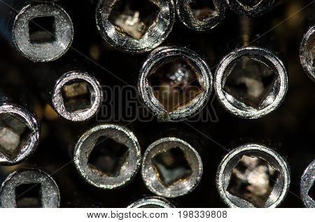 Abstract: View Into the Barrel of a Set of Antique Pocket Watch Keys