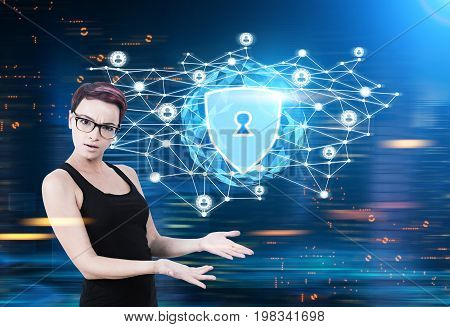 Close up of a surprised nerd woman with purple hair wearing glasses and a black tank top. She is standing against a glowing security shield hologram. Blue. Toned image mock up double exposure