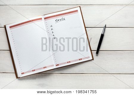 Opened Personal Organizer With Goals List Top View. Memo Planning Strategy Process Ideas Concept