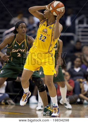 LOS ANGELES, CA. - SEPTEMBER 16: Swin Cash (L) defending against Tina Thompson (R) during the WNBA playoff game of the Sparks vs. Storm on September 16, 2009 in Los Angeles.