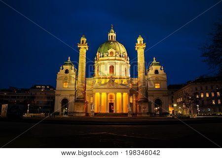 Vienna, Austria. Illuminated St Charles Church at night, Vienna, Austria with dark sky