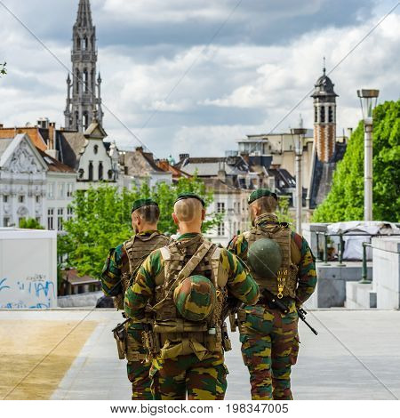 Military Patrol On The Street Of Brussels, Summer Day
