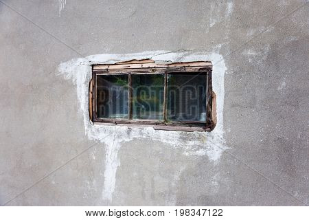 Little Old Windows. Small Rectangular Glass Window Wood Frame In The Web Of Dirty, Dusty Windows On