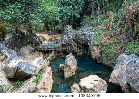 VANG VIENG LAOS - MARCH 14 2017: The beautiful Blue Lagoon with tropical vegetation at Tham Chang Cave close to the city of Vang Vieng Laos.