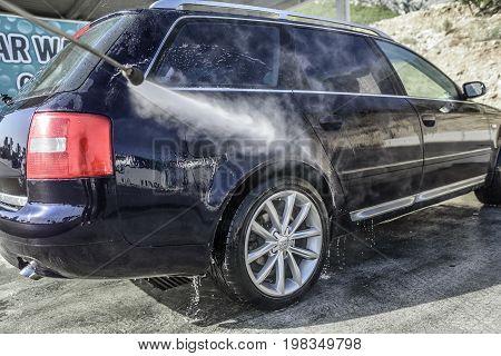 MAKARSKA, CROATIA - 10 JULY, 2017: Car Audi A6 in a high pressure washer.