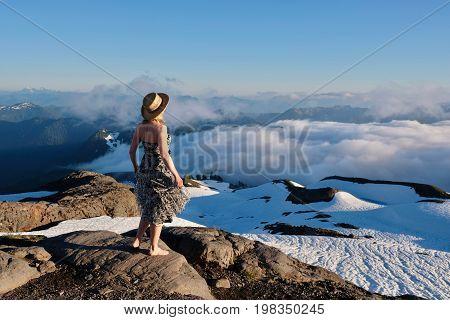 Woman on mountain top enjoying scenic views. Seattle. North Cascades National Park. Mount Baker. Washington. United States.