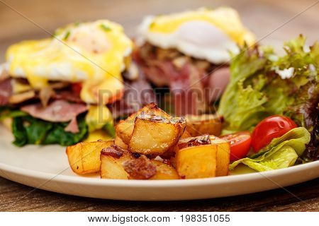 Hamburger , burger with grilled beef, egg, cheese, bacon and vegetables in white plate on wooden serface.
