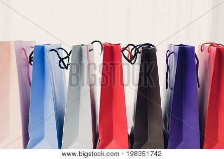 sale consumerism advertisement and retail concept - many colorful shopping bags