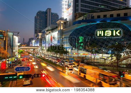 BangkokThailand - April 042015 : Time-lapse Traffic on street and MBK Center Bangkok Shopping Mall on April 042015 at Bangkok Thailand. MBK Center also known as Mahboonkrong is a large shopping mall